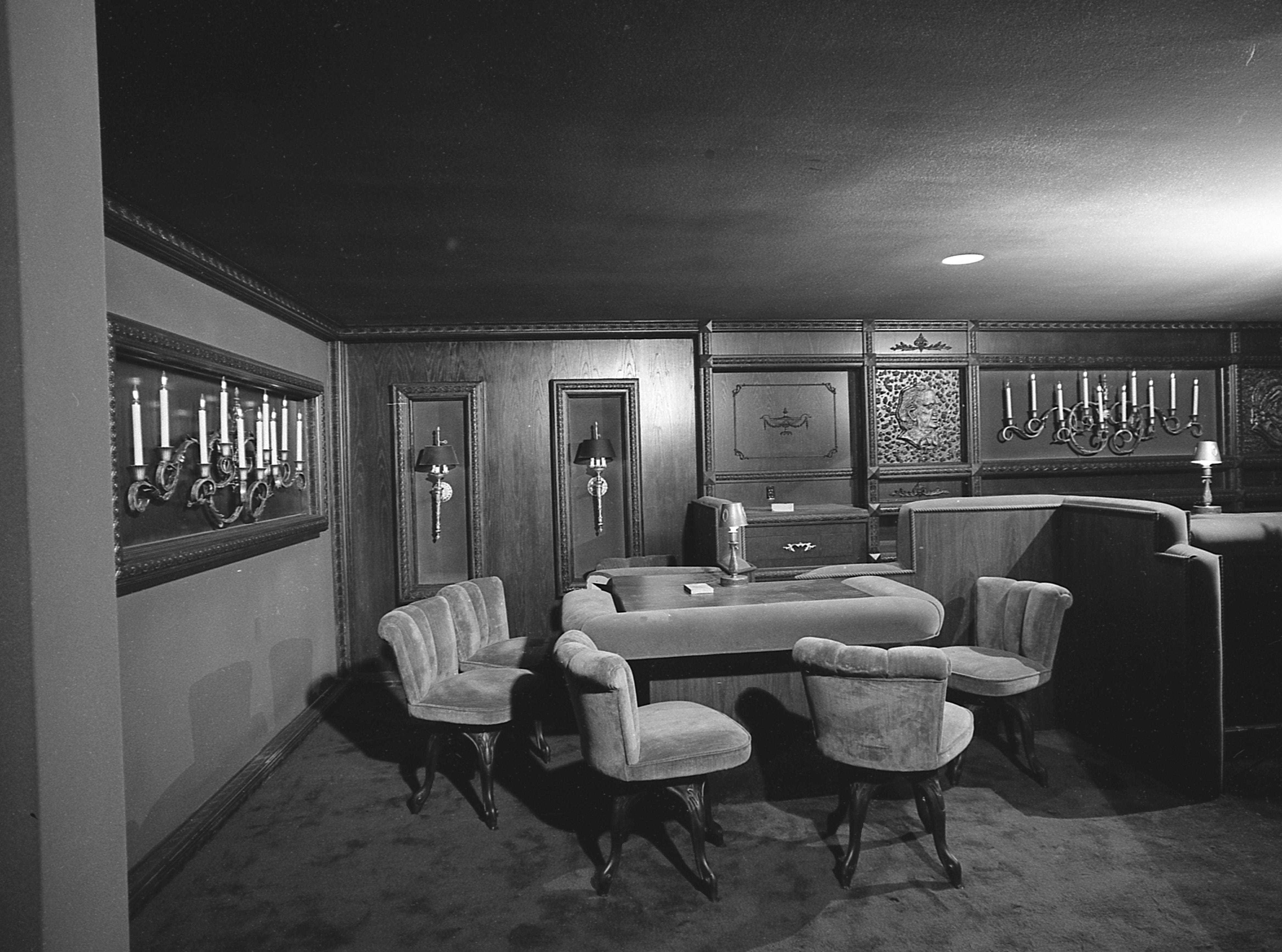 """35mm film negative of the new Milwaukee Performing Arts Center (now known as the Marcus Center for the Performing Arts) or PAC at 929 N. Water St. Construction began on June 27, 1966. This photo shows the interior of the restaurant,  the Velvet Chair.   This photo was in the Sept. 14 edition of the Journal with the caption """"Mahogany paneling and green velvet turned the brick of a rathskeller into the Velvet Chair."""" Date is  9/14/1969   building, music, performance, stage, theater, Uihlein Hall, Todd Wehr hall, Peck Pavilion. Neg. #69592"""