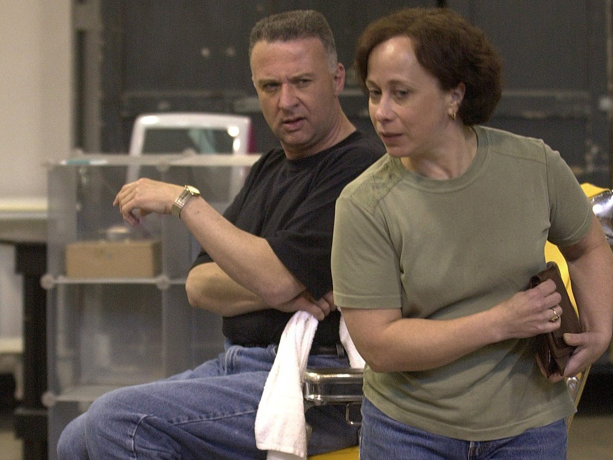 """Actor John McGivern, who plays the role of """"Tony Whitcomb,"""" hairstylist and owner of Shear Madness Salon in the Milwaukee Repertory Theater production of Shear Madness rehearses with Jenny Wanasek who plays """"Mrs. Schubert."""""""