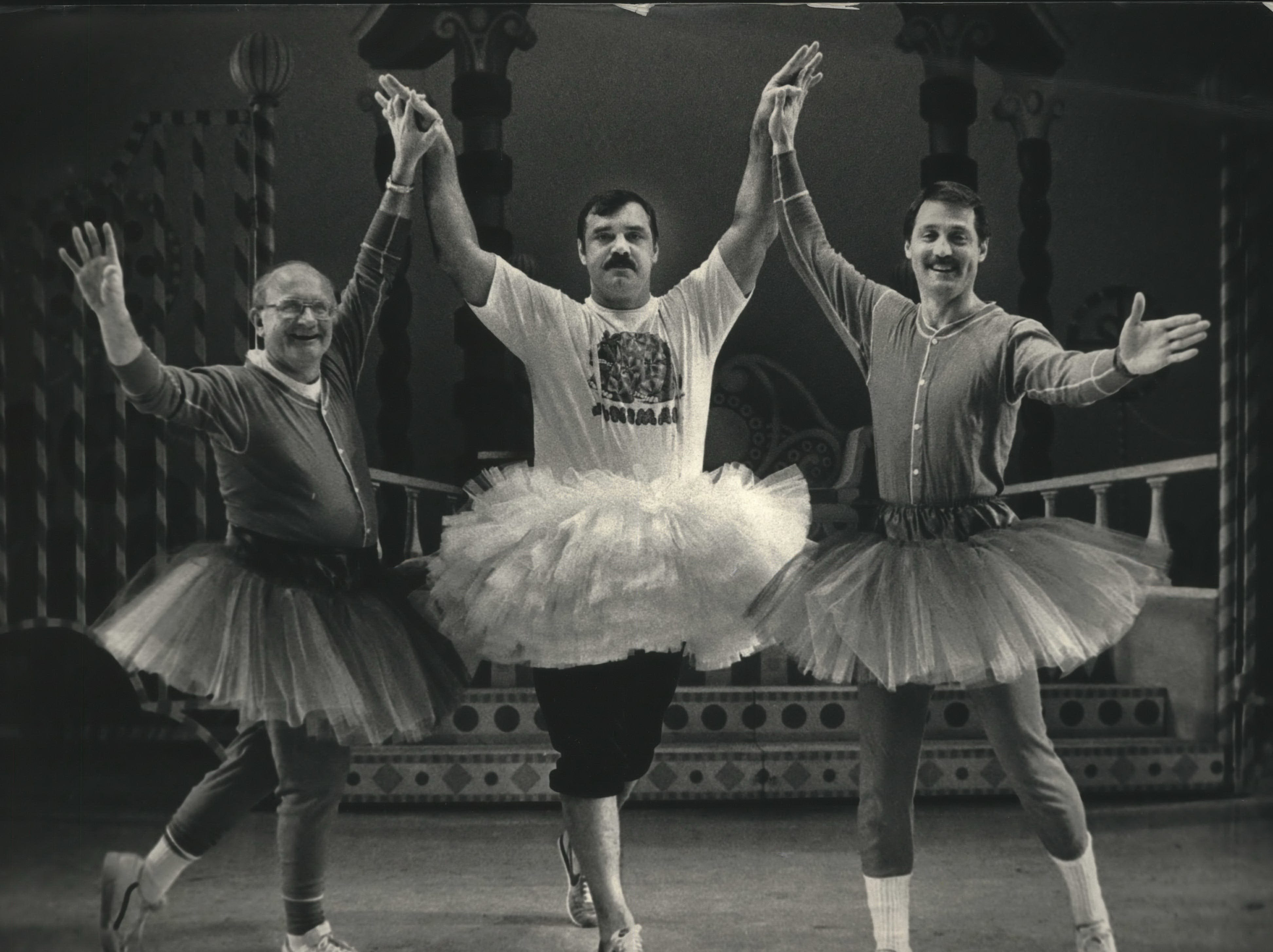 """It was a """"Nutty Nutcracker"""" Thursday (from left) County Board CHairman F. Thomas Ament, former football player Larry Csonka and Tom Sutton of WISN-TV practiced for the third New Year's Eve spoof of """"The Nutcracker"""" ballet at the PAC. Pennsylvania and Milwaukee Ballet."""