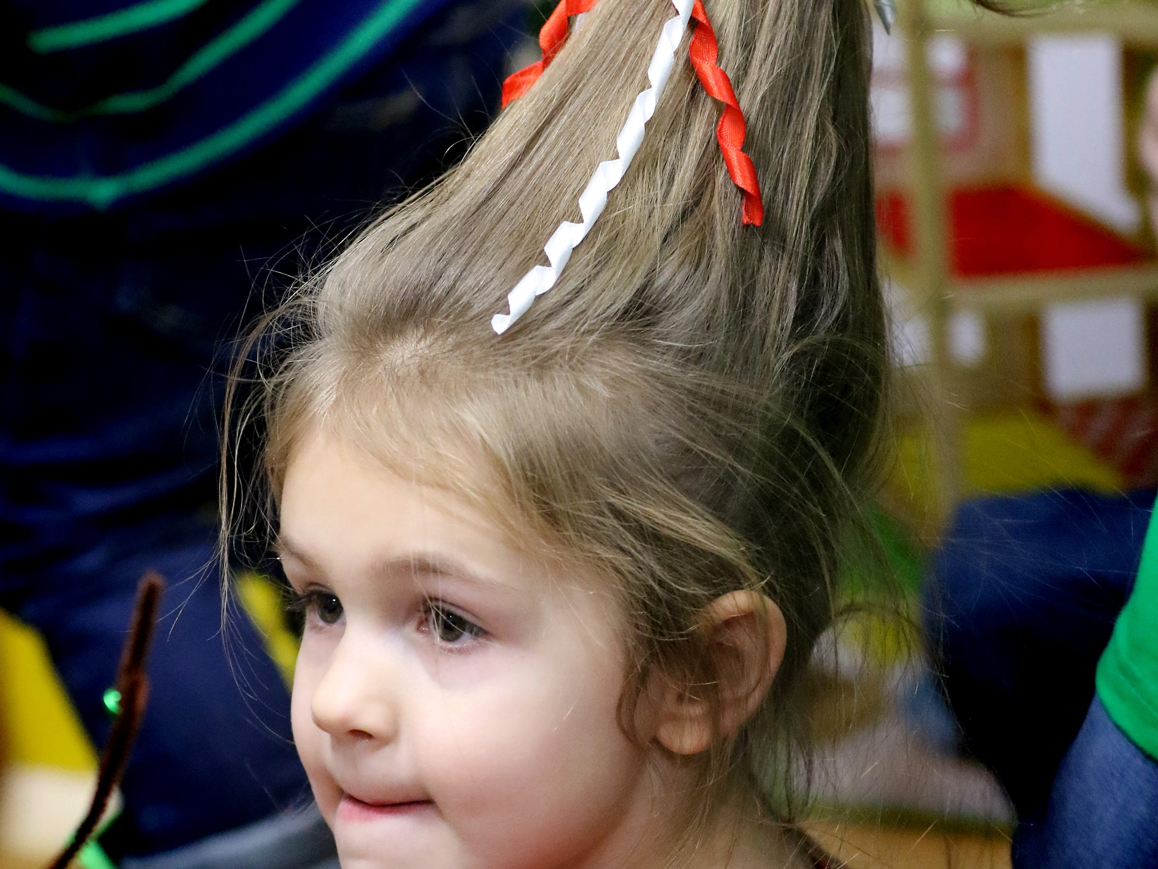 Piper Philleo, 4, sports a Whoville hairdo for Grinchmas in Pewaukee at Silly Willyz on Dec 6.