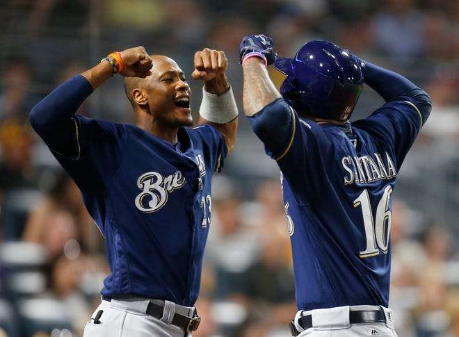 The Brewers aren't likely to keep both Keon Broxton (left) and Domingo Santana, since the outfielders have no minor-league options left.