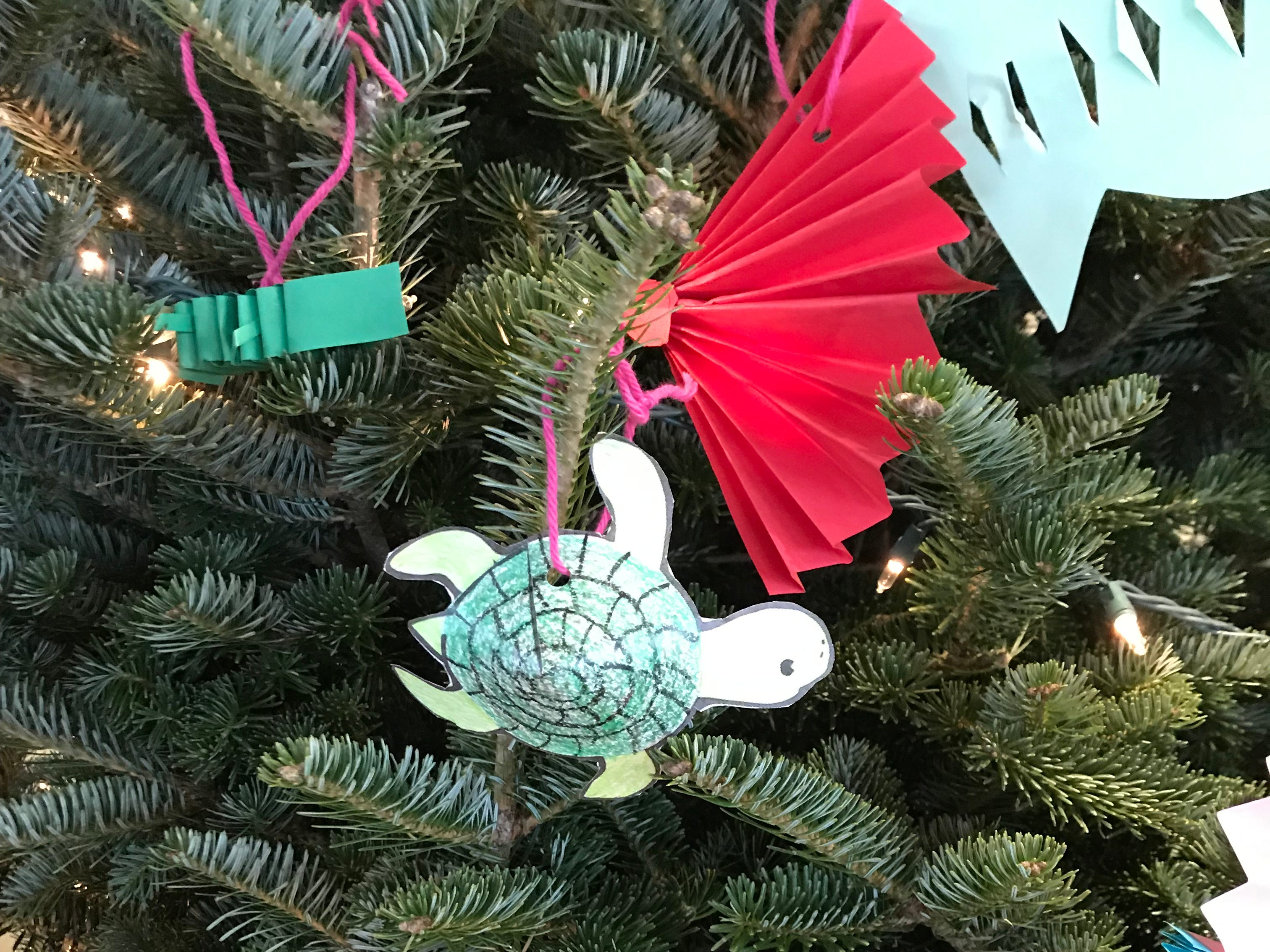 Many creative ornaments can be made from paper, including turtles and fans like these by Divine Mercy Elementary on display at the Milwaukee County Zoo.
