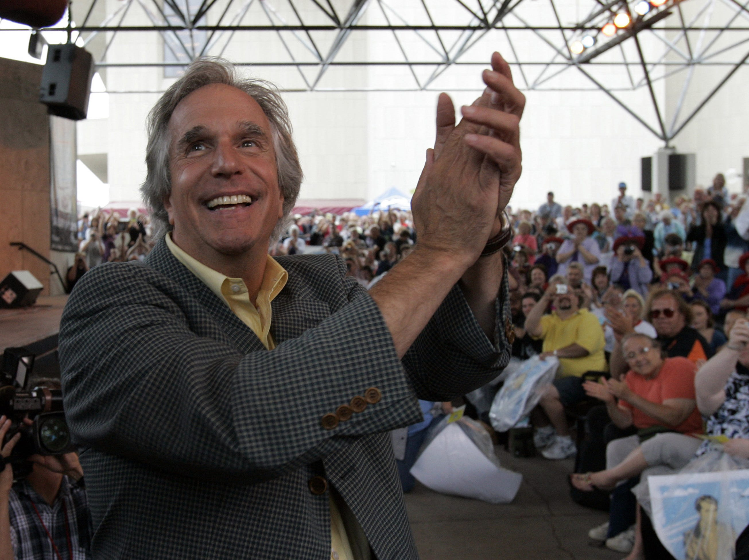 """Henry Winkler,  known as """"The Fonz"""" from the Milwaukee-based television show """"Happy Days,"""" welcomes the public at the Marcus Performing Arts Center for the dedication of """"The Bronz Fonz,"""" a statue commemorating him and the show."""