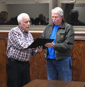 Mountain Home Mayor Joe Dillard (left) presents Paul Norell with a certificate expressing the appreciation of the City of Mountain Home and the Mountain Home Cemetery Board for Norell's volunteer efforts with the Mountain Home Cemetery. Norell was recognized at the Dec. 6 Mountain Home City Council meeting.