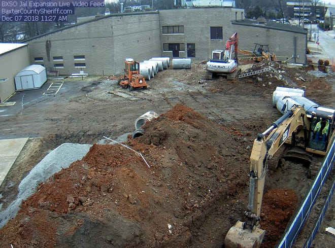 As seen through the live feed provided by the Baxter County Sheriff's Office, workers on Friday remove dirt at the site of the planned 50-bed expansion to the county's detention center. The project's nearly $2.9 million price tag helped pushed the county's 2019 budget to more than $18 million.