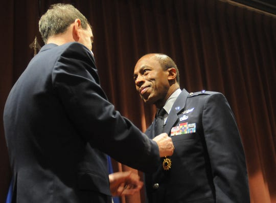 Air Force Brig. Gen. Ed Crowell smiles as Gen. Stephen Lorenz, commander of Air Education and Training Command, pins the Distinguished Service Medal on him during Crowell's retirement ceremony at Maxwell Air Force Base Friday, Jan. 23, 2009.