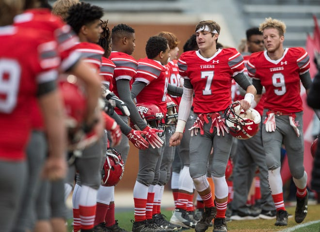 Luverne's Tanner Simmons (7) and Luverne's Dionte' Brantley (9) high five teammates as they are introduced before the Class 2A state championship at Jordan-Hare Stadium in Auburn, Ala., on Friday, Dec. 7, 2018. Fyffe leads Luverne 7-6 at halftime.