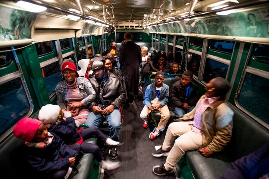 Twins and their families ride the Rosa Parks bus to the Harlem Globetrotters game as part of a field trip for the twins at Peter Crump Elementary School in Montgomery, Ala., on Thursday evening December 6, 2018.