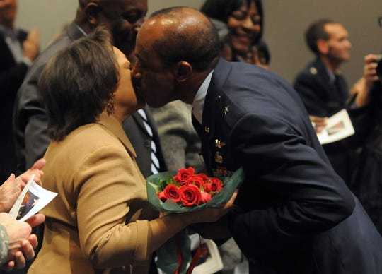 Air Force Brig. Gen. Ed Crowell kisses wife Ernestine during his retirement ceremony at Maxwell Air Force Base Friday, Jan. 23, 2009.