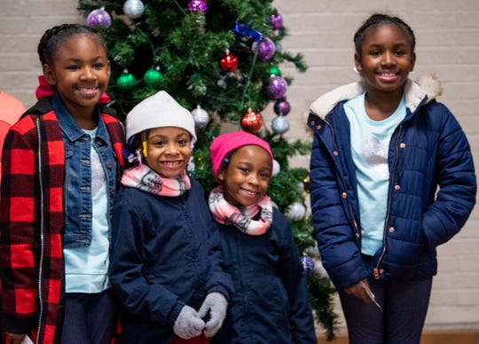 Twins Meghan Bradshaw, left, and Mahlori Bradshaw, right, and twins Machaiya Johnson and Makayla Johnson pose for a photo before going to see the Harlem Globetrotters game as part of a field trip for the twins at Peter Crump Elementary School in Montgomery, Ala., on Thursday evening December 6, 2018.