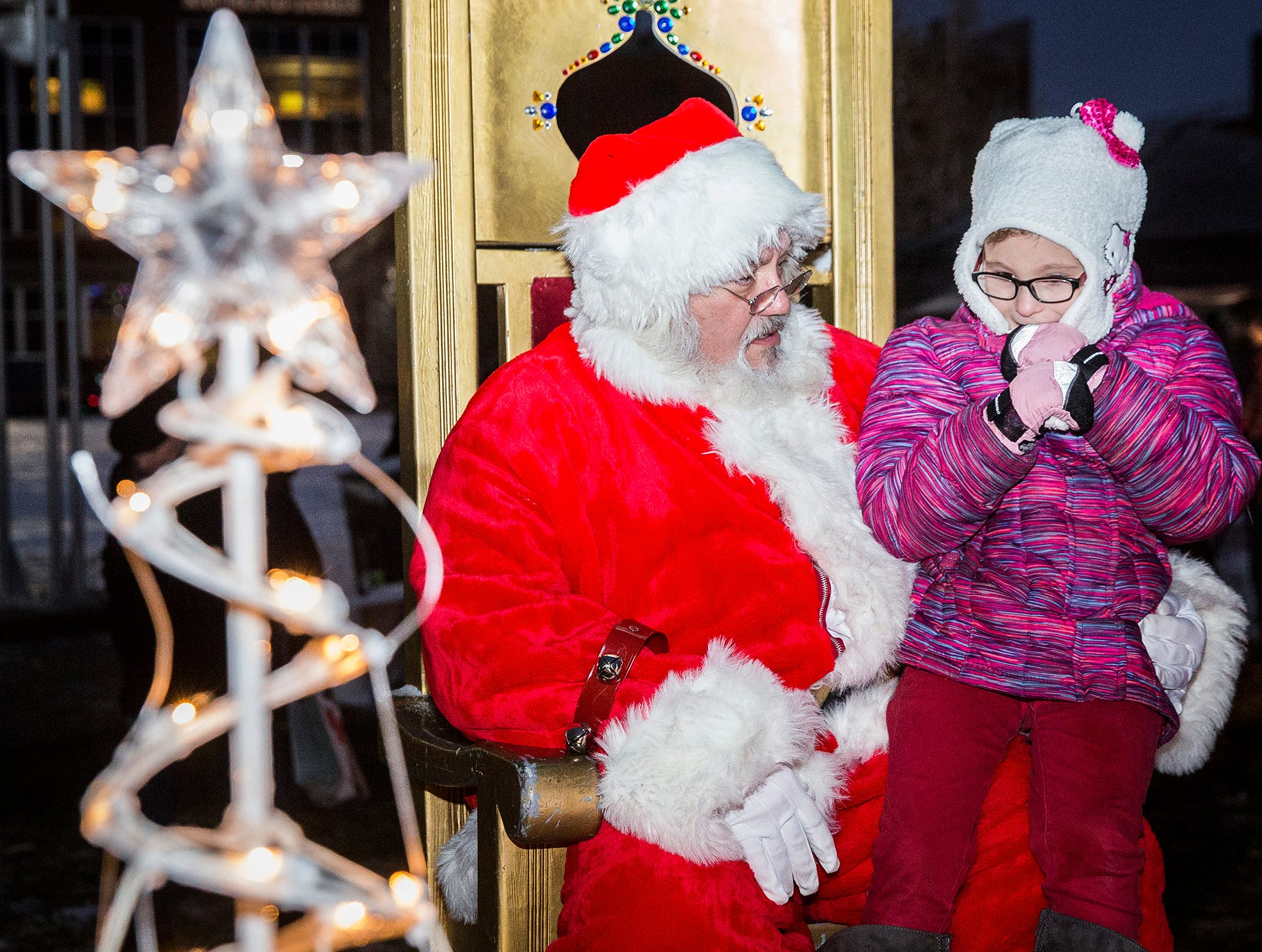 Attendees of Light Up DWNTWN watched a Christmas tree light show, performances by the Muncie Community School's Elementary Choir and Ball State's Code Red Dance team and browsed local vendors at the Muncie Makers Market at Canan Commons Thursday evening.