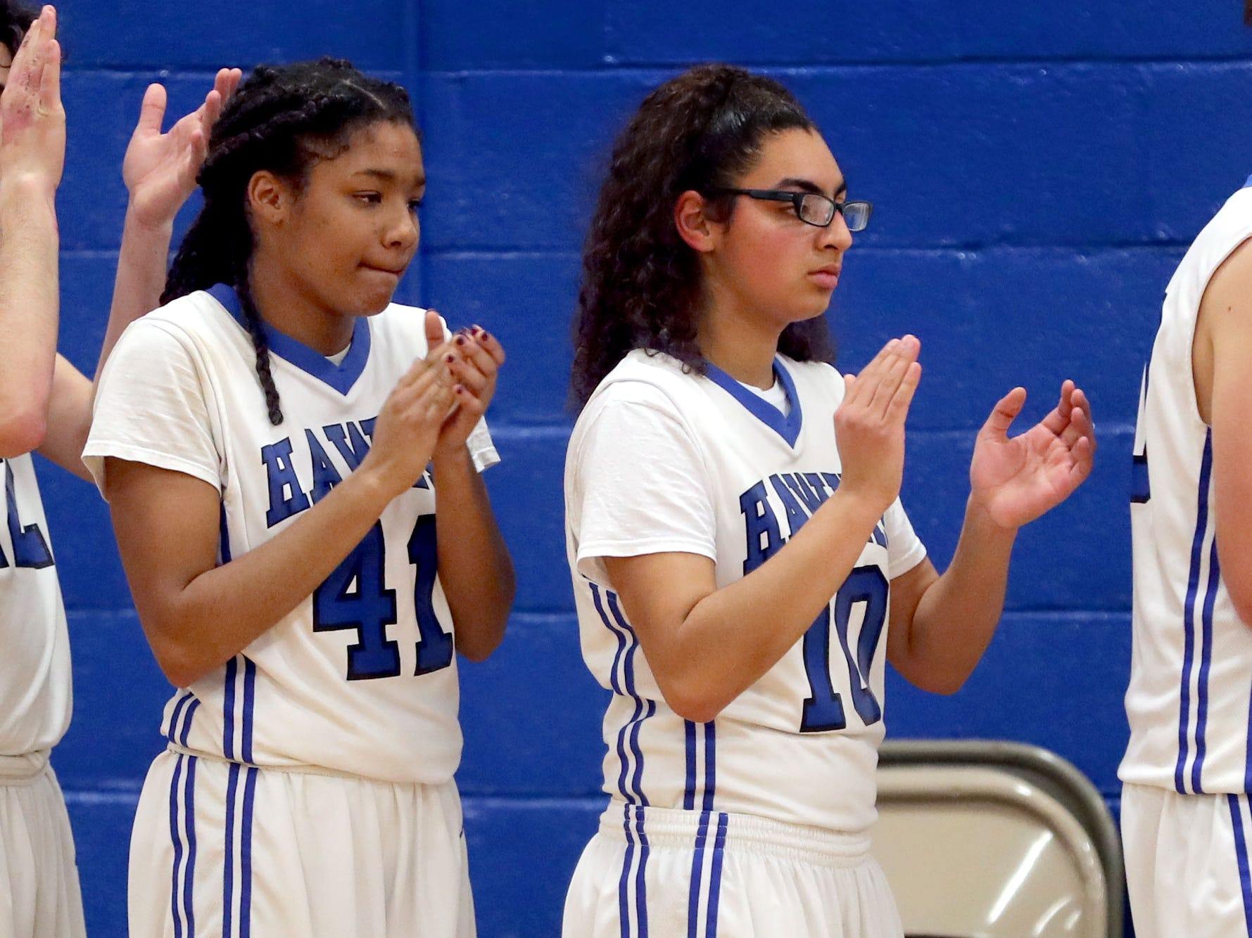 HollowayÕs Shelby Utley (41) and HollowayÕs Aaliyah Morales (10) clap after the anthem before the game against Central at Holloway on Thursday, Dec. 6, 2018.