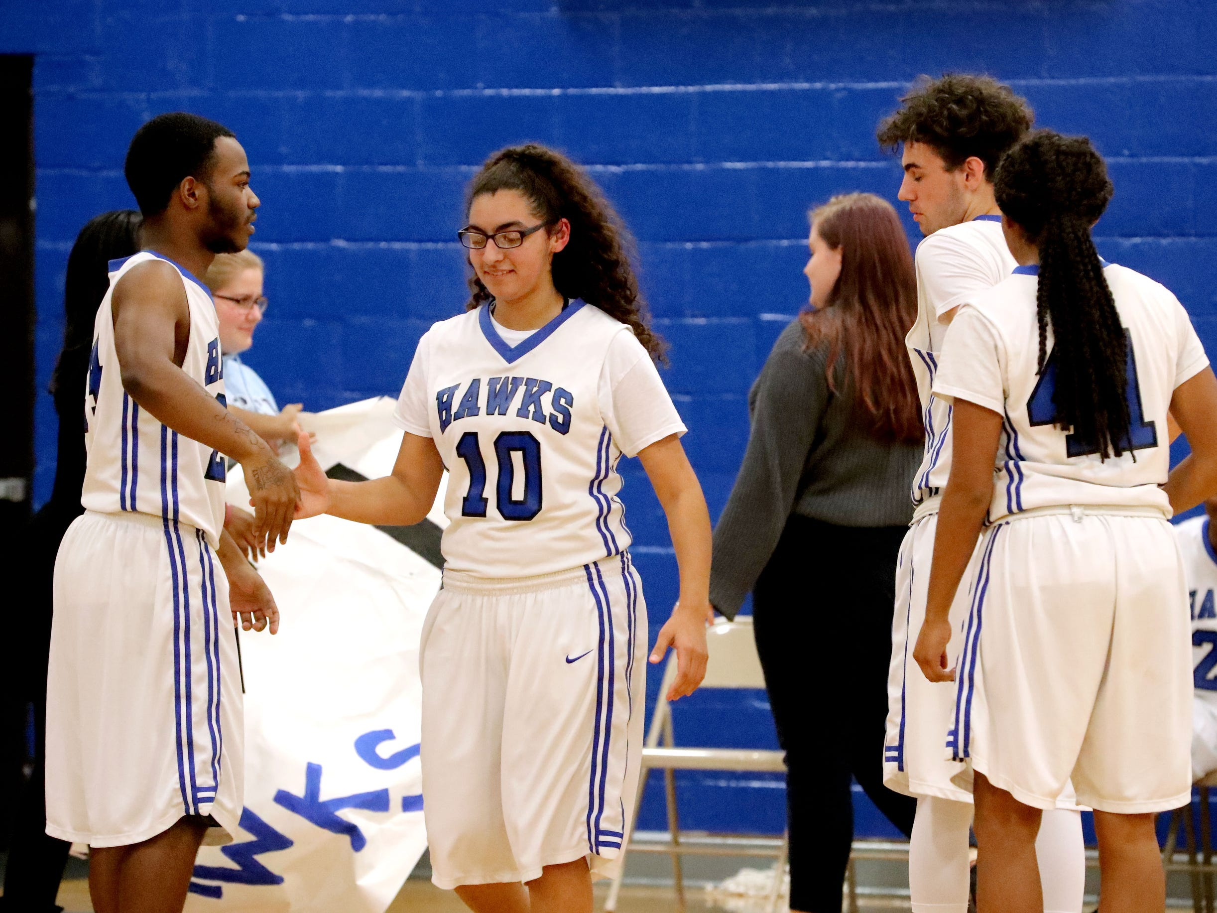 Holloway's Aaliyah Morales (10) is introduced before the game against Central and comes out and shake the hand of Holloway's Aundrell Hughes (2) on Thursday, Dec. 6, 2018.