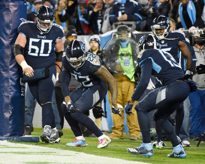 Titans running back Derrick Henry (22) celebrates his third touchdown with his teammates in the third quarter Thursday.