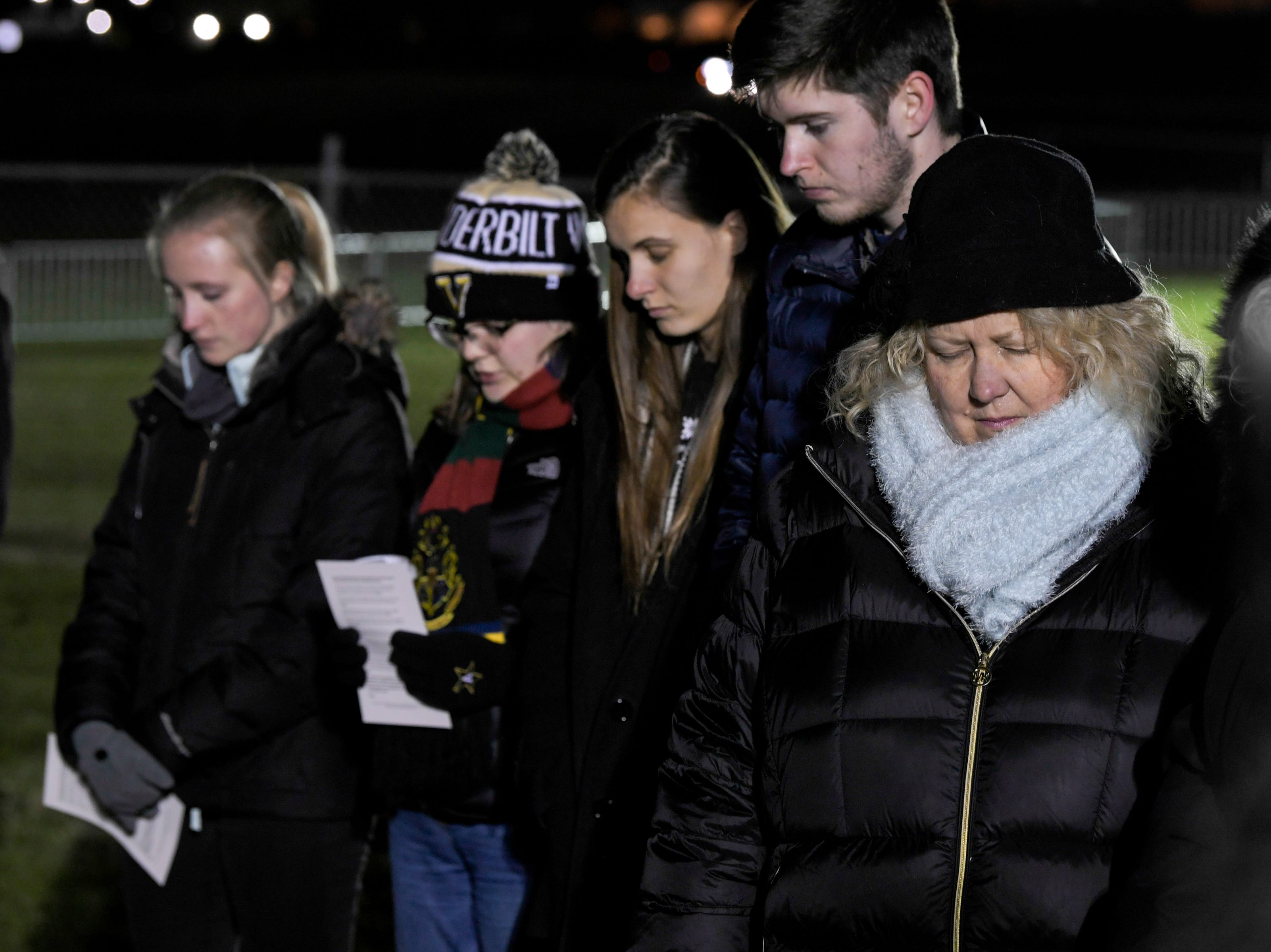 Protesters against the death penalty take a moment of silence in a field outside Riverbend Maximum Security Institution before the execution of Tennessee death row inmate David Earl Miller on Thursday, Dec. 6, 2018 in Nashville, Tenn. Miller was sentenced to death for the 1981 murder of Lee Standifer, 23, in Knoxville.