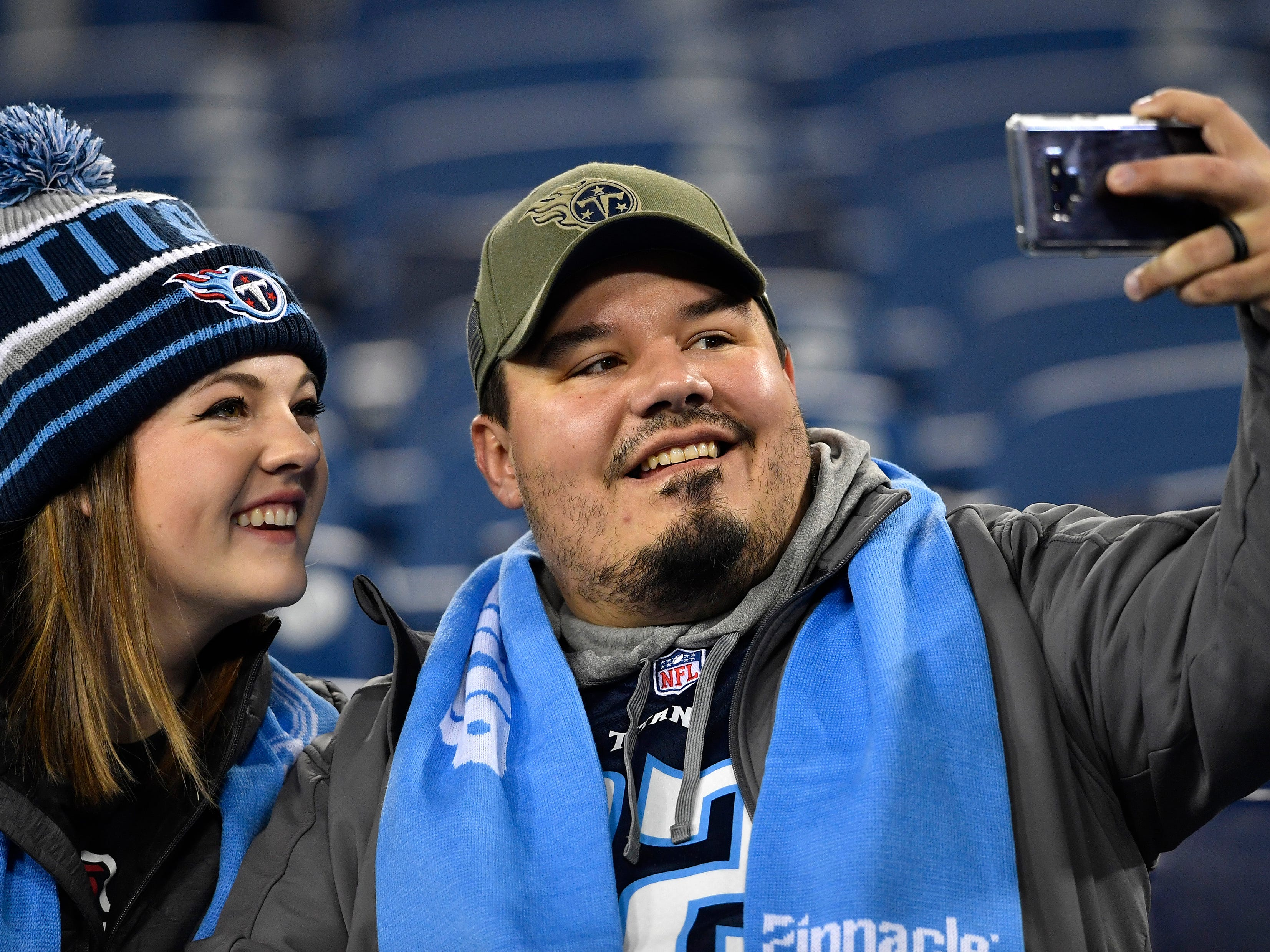 Titans fans take a selfie before the game against the Jaguars at Nissan Stadium Thursday, Dec. 6, 2018, in Nashville, Tenn.