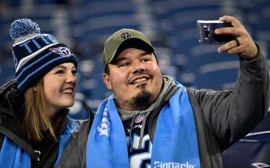 Titans fans take a selfie before the game against the Jaguars at Nissan Stadium Thursday, Dec. 6, 2018, in Nashville, Tenn.