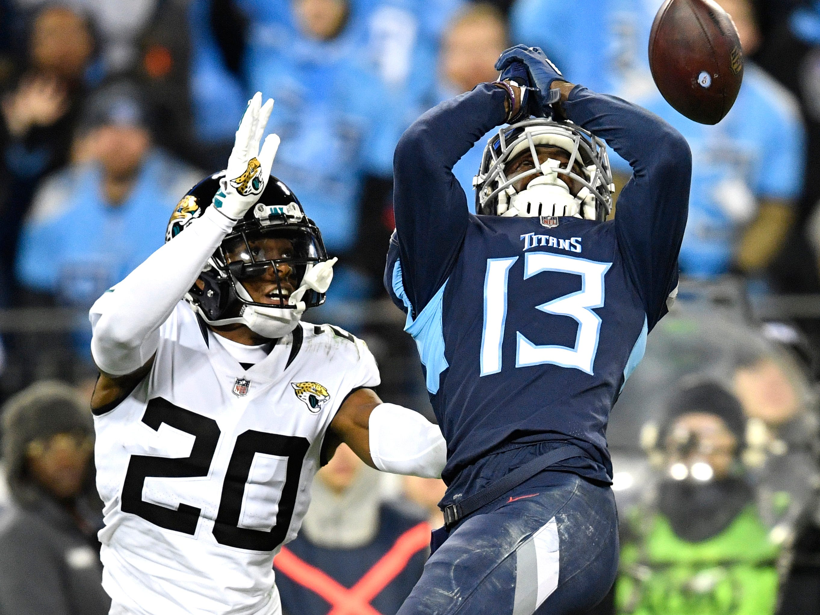 Jaguars cornerback Jalen Ramsey (20) breaks up a pass intended for Titans wide receiver Taywan Taylor (13) in the second quarter at Nissan Stadium Thursday, Dec. 6, 2018, in Nashville, Tenn.