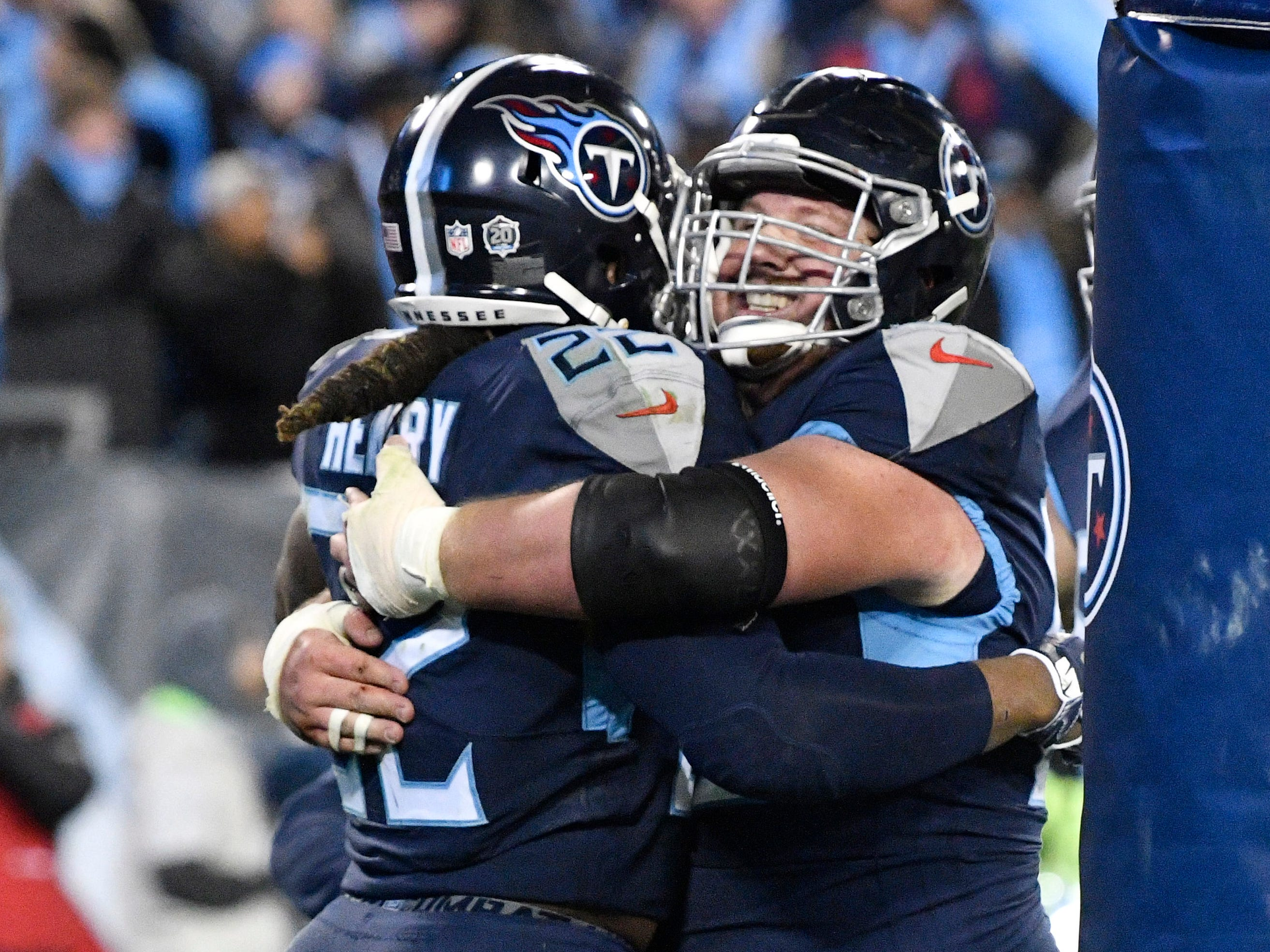 Titans running back Derrick Henry (22) celebrates his third touchdown with center Ben Jones (60) in the third quarter at Nissan Stadium Thursday, Dec. 6, 2018, in Nashville, Tenn.
