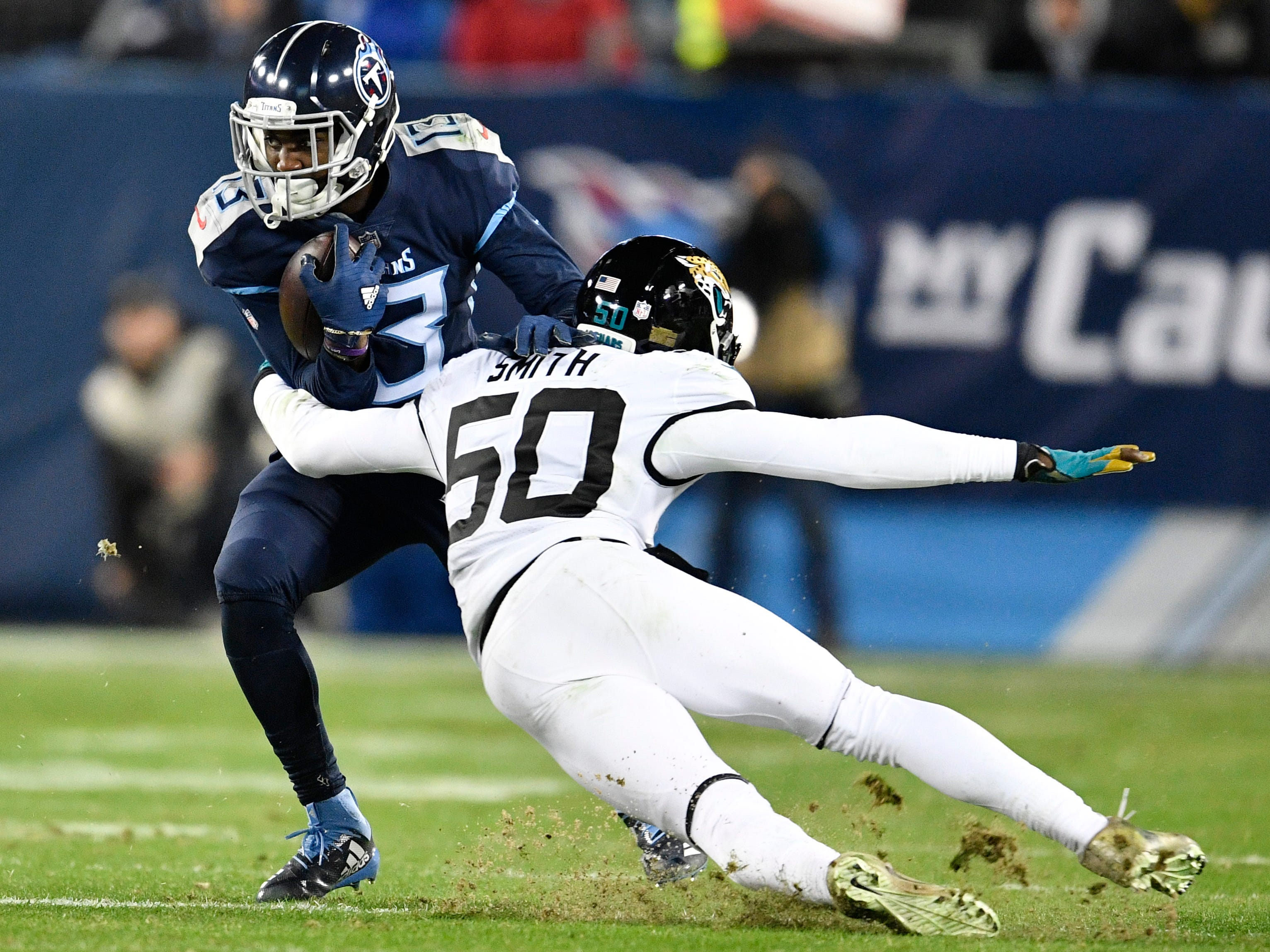 Titans wide receiver Taywan Taylor (13) escapes from Jaguars linebacker Telvin Smith (50) in the second quarter at Nissan Stadium Thursday, Dec. 6, 2018, in Nashville, Tenn.