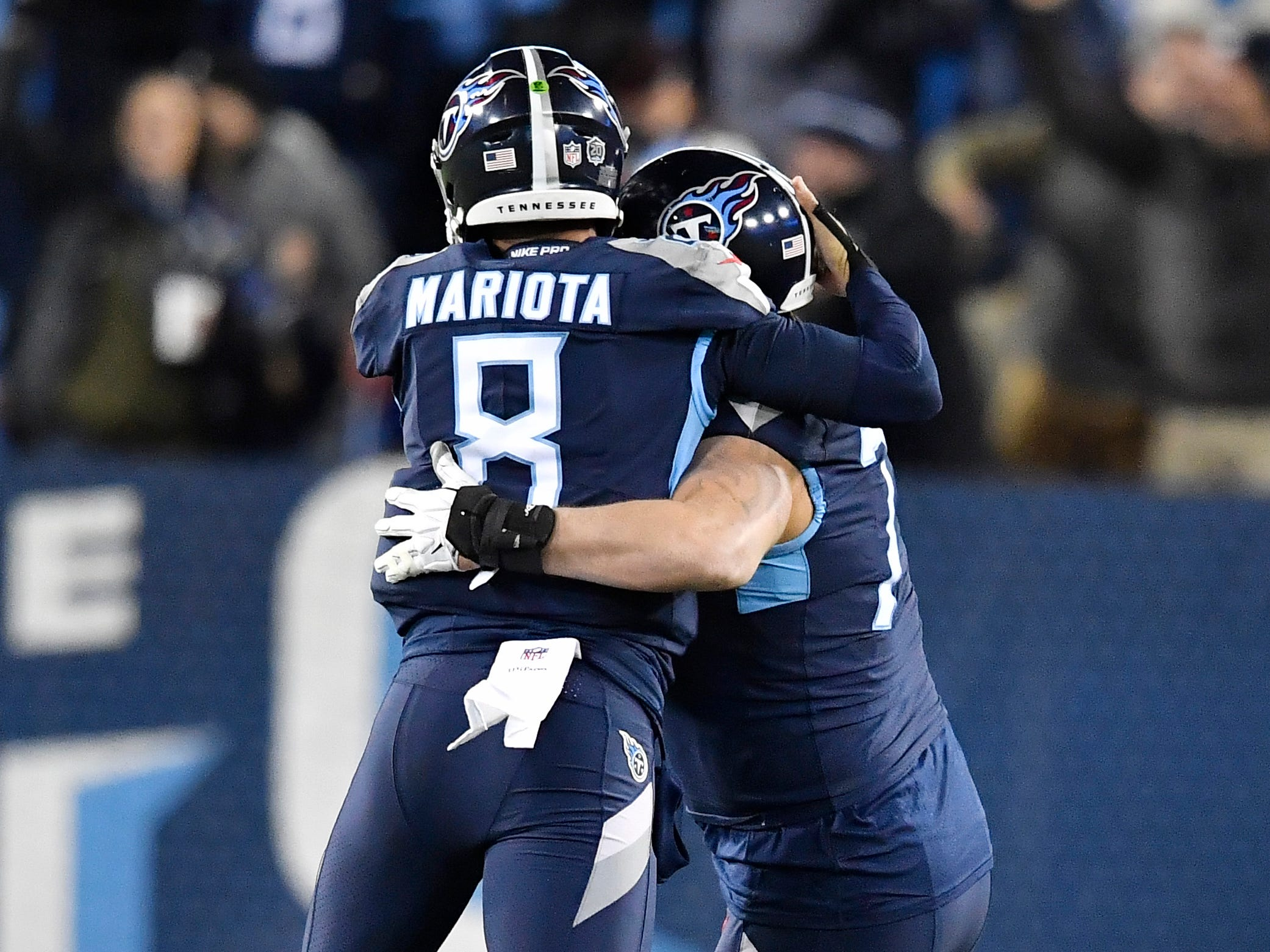 Titans quarterback Marcus Mariota (8) celebrates Derrick Henry's 99-yard touchdown with offensive tackle Taylor Lewan (77) in the second quarter at Nissan Stadium Thursday, Dec. 6, 2018, in Nashville, Tenn.