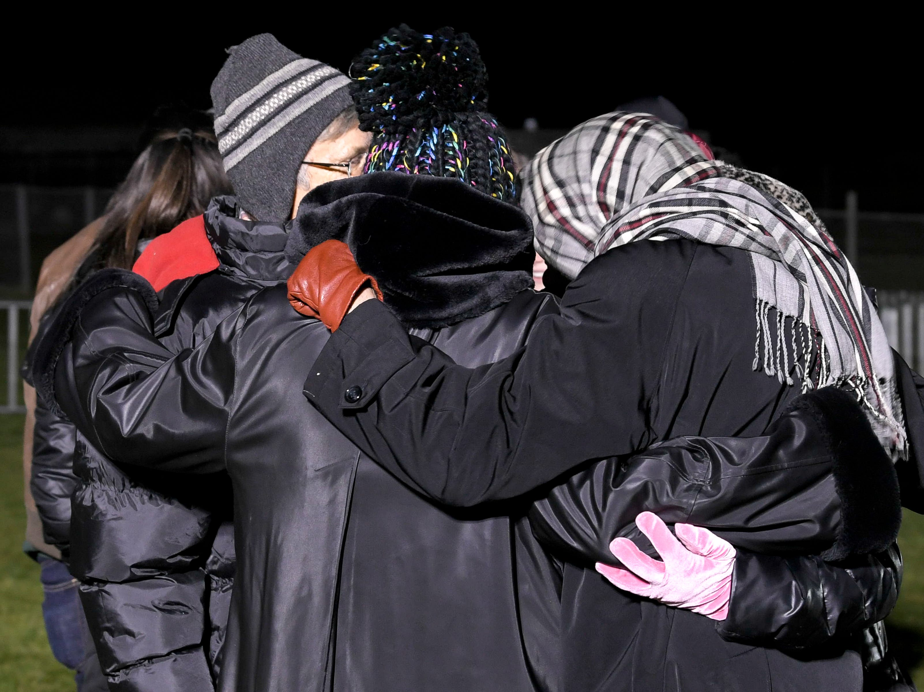 Protesters against the death penalty hug in a field outside Riverbend Maximum Security Institution after the execution of Tennessee death row inmate David Earl Miller on Thursday, Dec. 6, 2018 in Nashville, Tenn. Miller was sentenced to death for the 1981 murder of Lee Standifer, 23, in Knoxville.