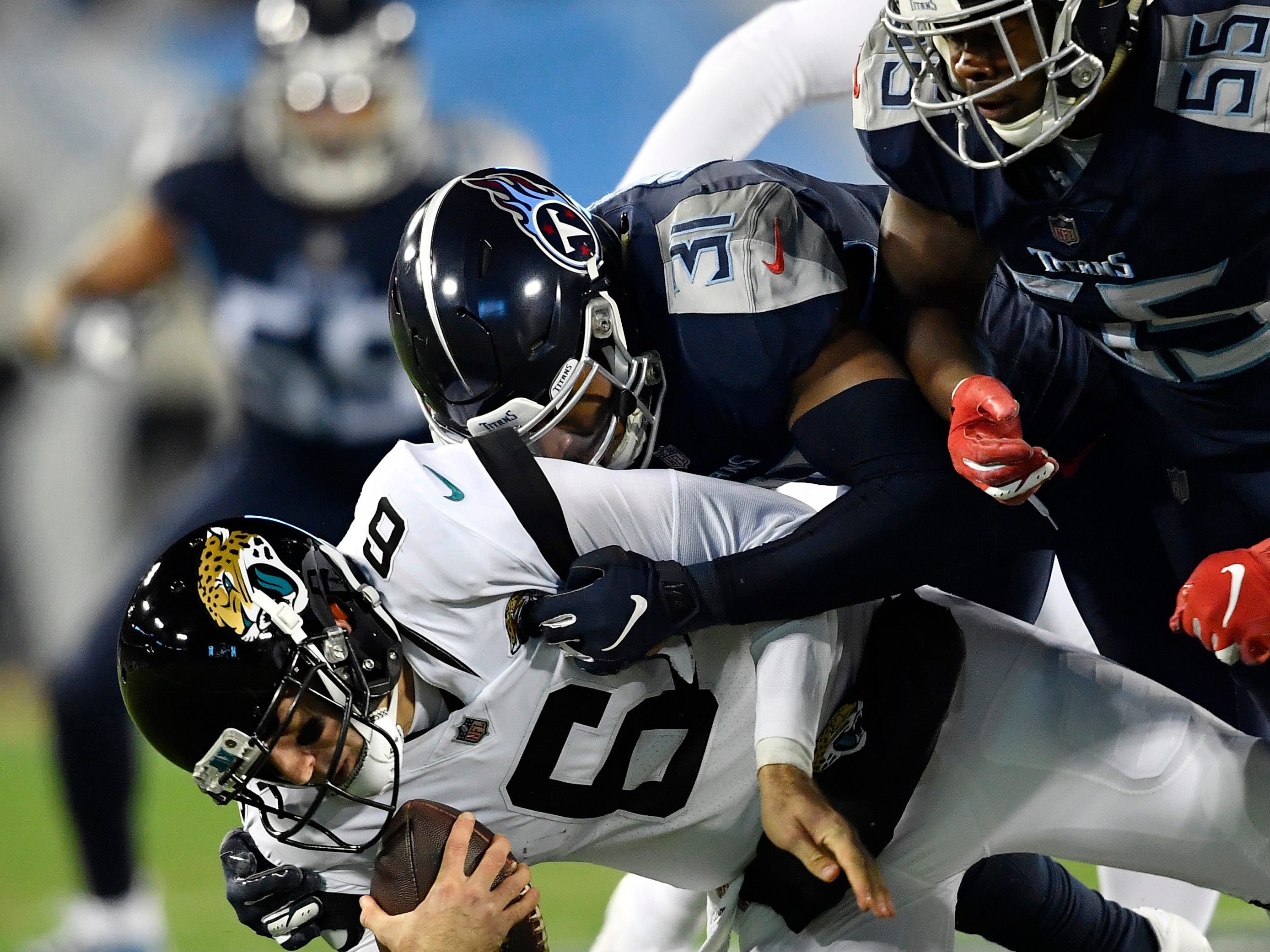 Titans safety Kevin Byard (31) and linebacker Jayon Brown (55) sack Jaguars quarterback Cody Kessler (6) in the first half at Nissan Stadium Thursday, Dec. 6, 2018, in Nashville, Tenn.