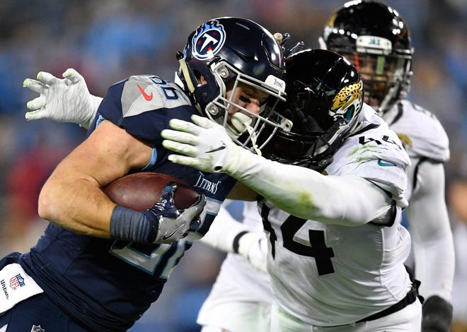 Titans tight end Anthony Firkser (86) collides with Jaguars linebacker Myles Jack (44) in the fourth quarter Thursday.