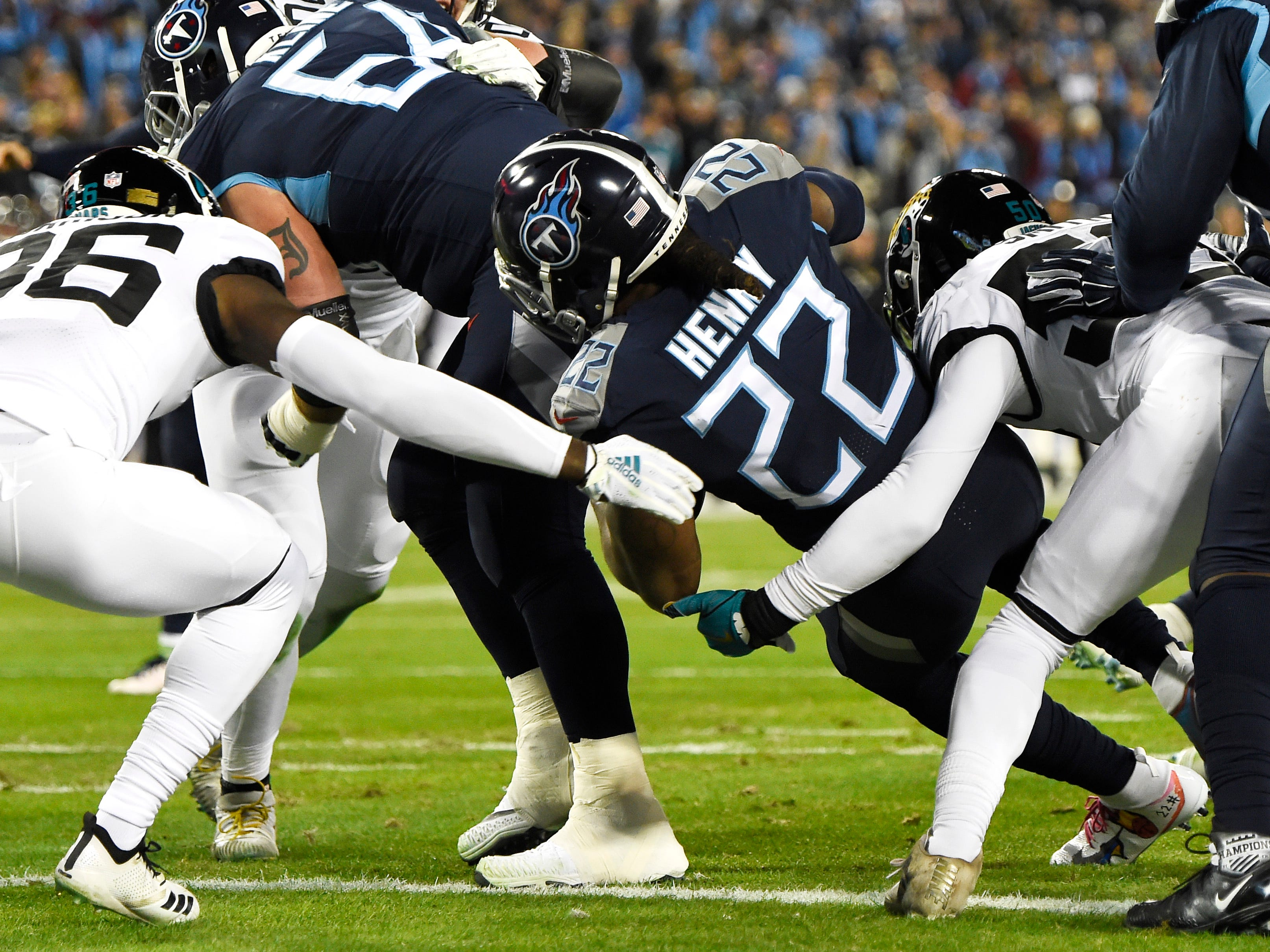 Titans running back Derrick Henry (22) scores his first touchdown against the Jags in the first quarter at Nissan Stadium Thursday, Dec. 6, 2018, in Nashville, Tenn.
