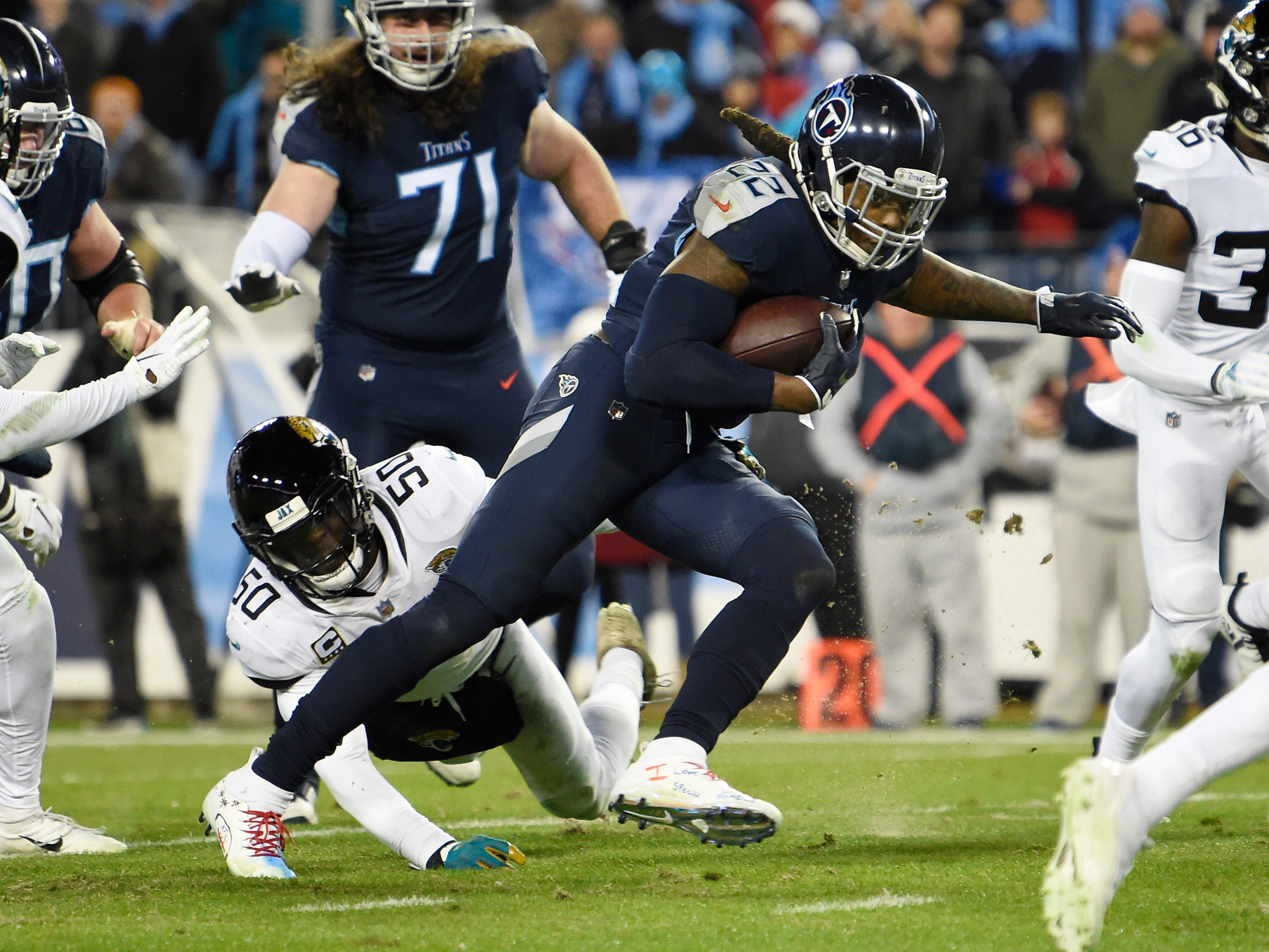 Titans running back Derrick Henry (22) scores his third touchdown of the night in the third quarter at Nissan Stadium Thursday, Dec. 6, 2018, in Nashville, Tenn.