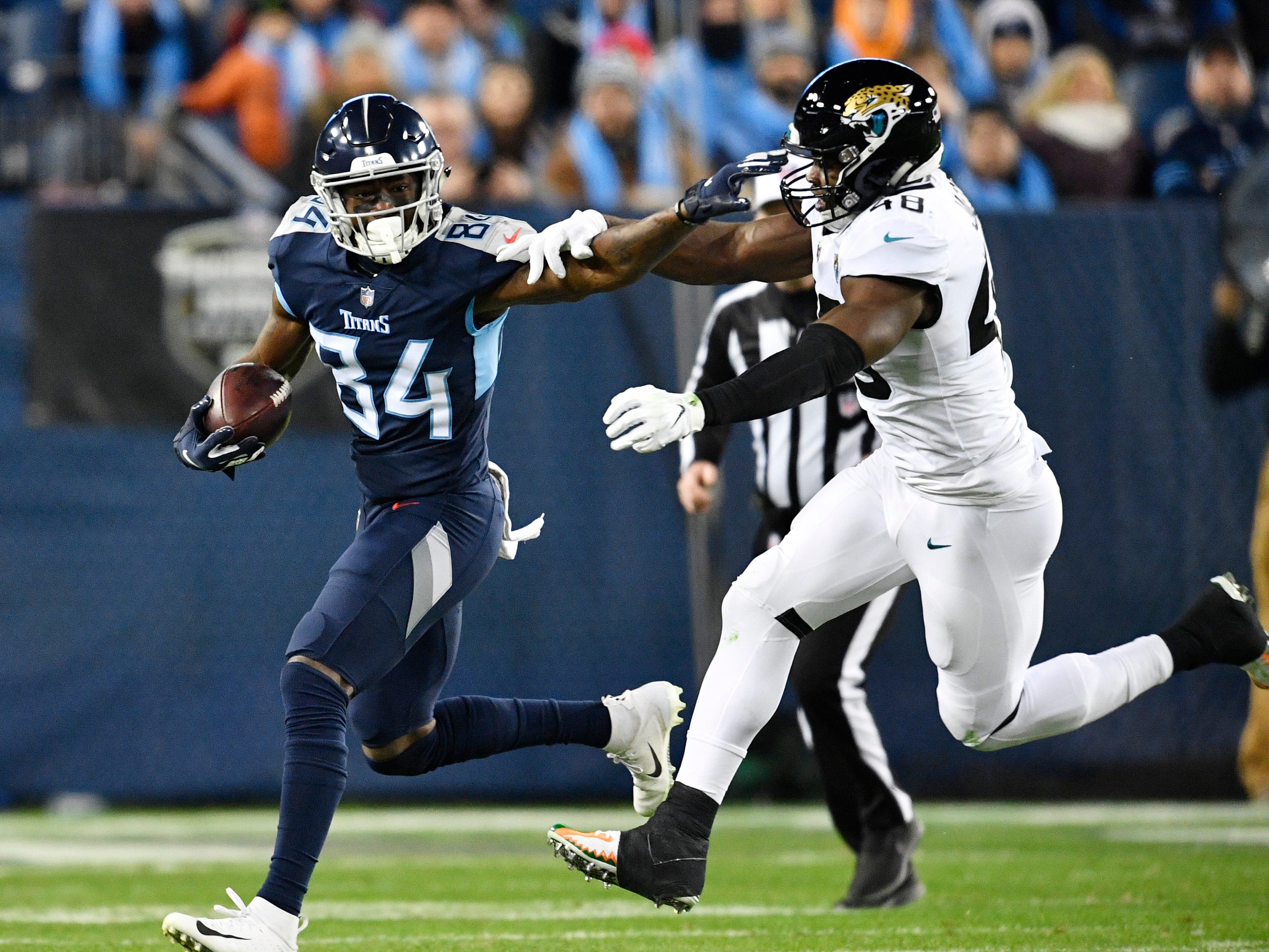Titans wide receiver Corey Davis (84) gains yards after a catch in the first half at Nissan Stadium Thursday, Dec. 6, 2018, in Nashville, Tenn.