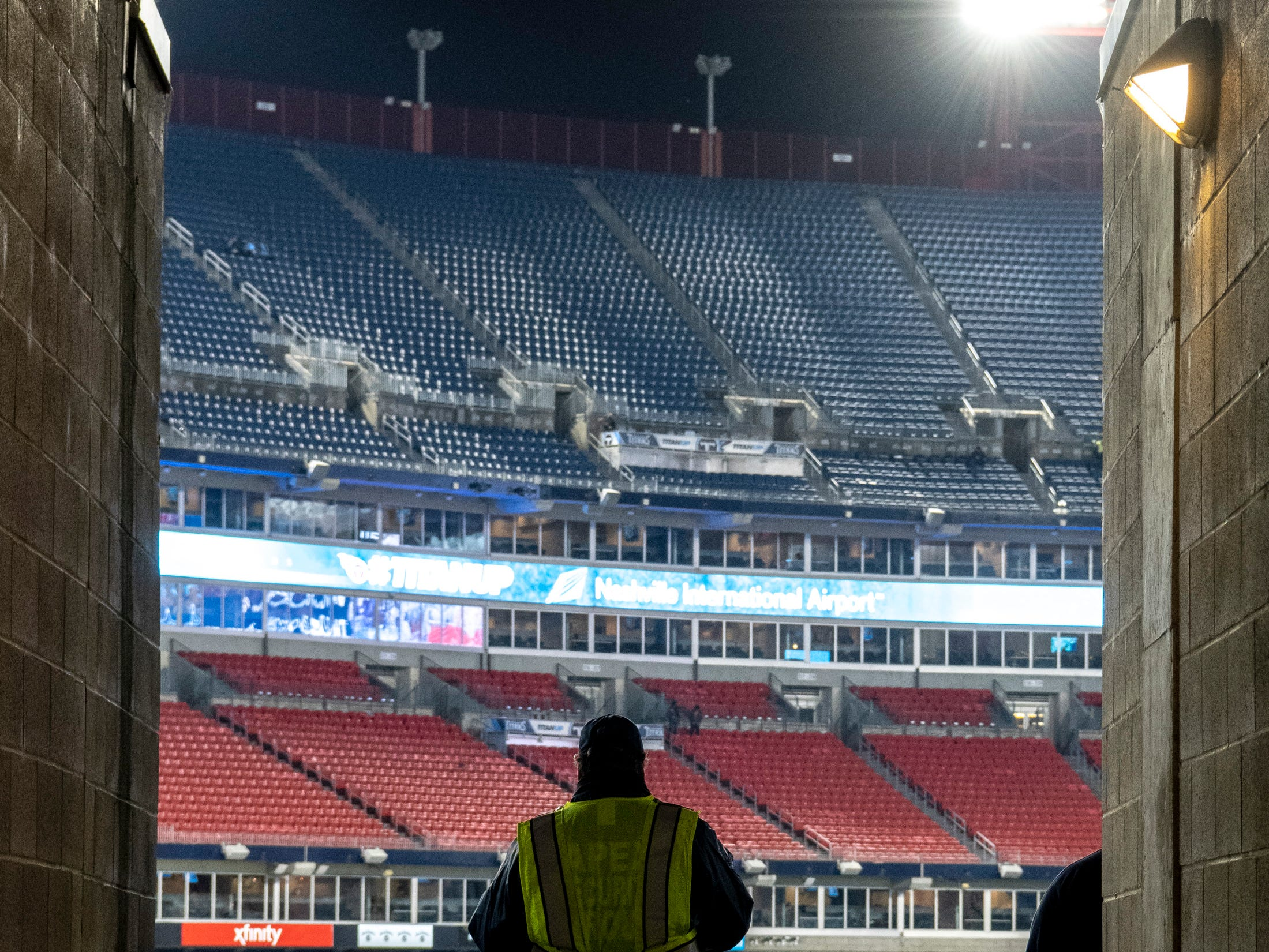 Security keeps watch as fans begin to arrive before the game between the Tennessee Titans and the Jacksonville Jaguars at Nissan Stadium in Nashville, Tenn., Thursday, Dec. 6, 2018.