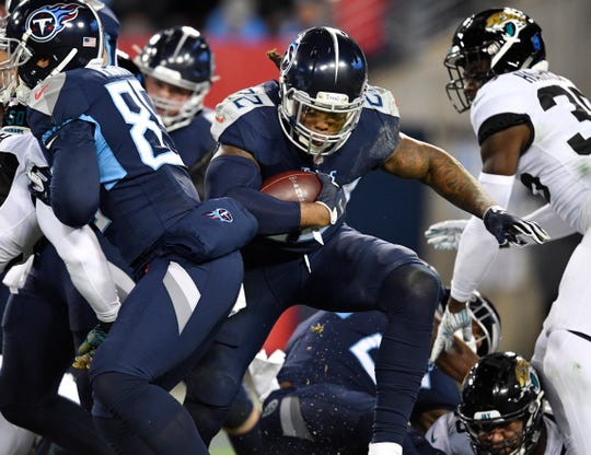 Titans running back Derrick Henry (22) takes off on his 99-yard touchdown run in the second quarter against the Jaguars on Dec. 6, 2018, at Nissan Stadium.