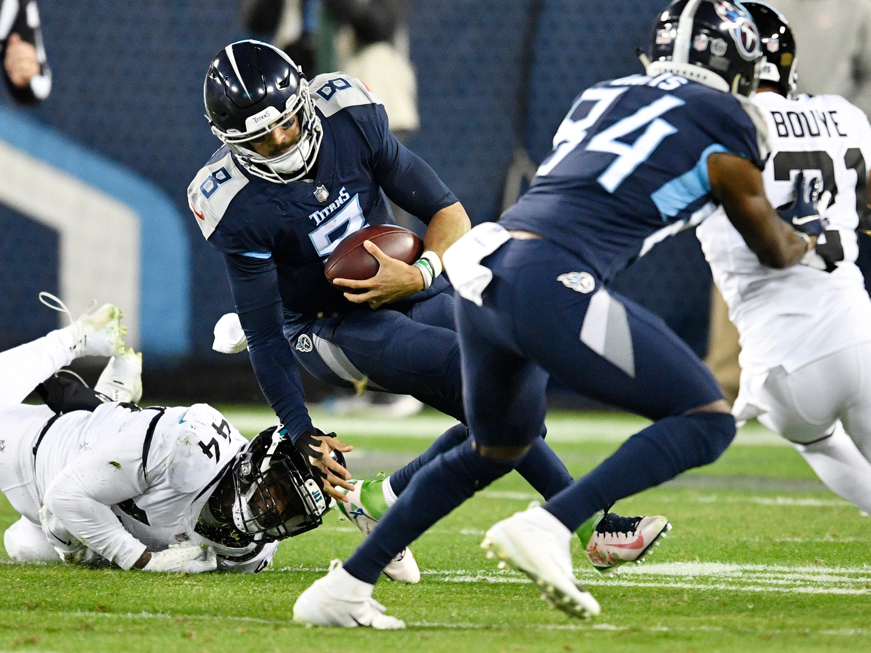 Titans quarterback Marcus Mariota (8) is brought down on a keeper in the second quarter at Nissan Stadium Thursday, Dec. 6, 2018, in Nashville, Tenn.