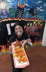 Aqui Hines, here in 2018, is owner and founder of 400 Degrees hot chicken.