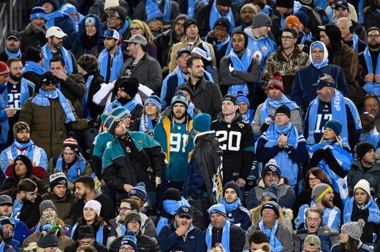 A sea of Titans fans surround a few Jags fans in the first half at Nissan Stadium Thursday, Dec. 6, 2018, in Nashville, Tenn.