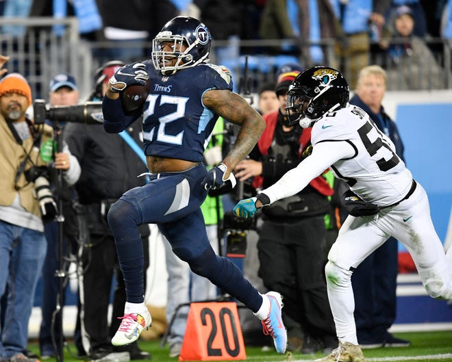 Titans running back Derrick Henry (22) scores his fourth touchdown of the game in the third quarter Thursday.