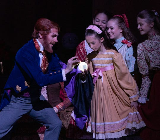 "Jon Upleger as Drosselmeyer with members of the youth cast in ""Nashville's Nutcracker."""