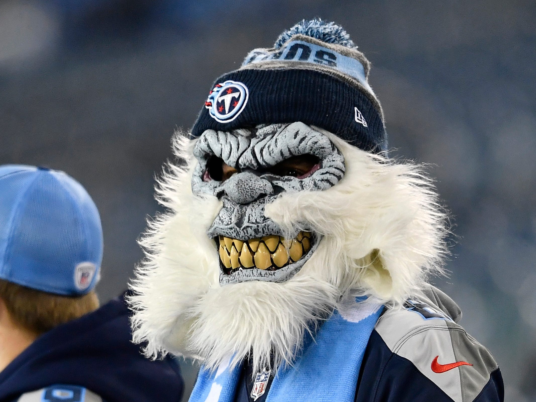 A Titans fan watches warmups before the game at Nissan Stadium Thursday, Dec. 6, 2018, in Nashville, Tenn.