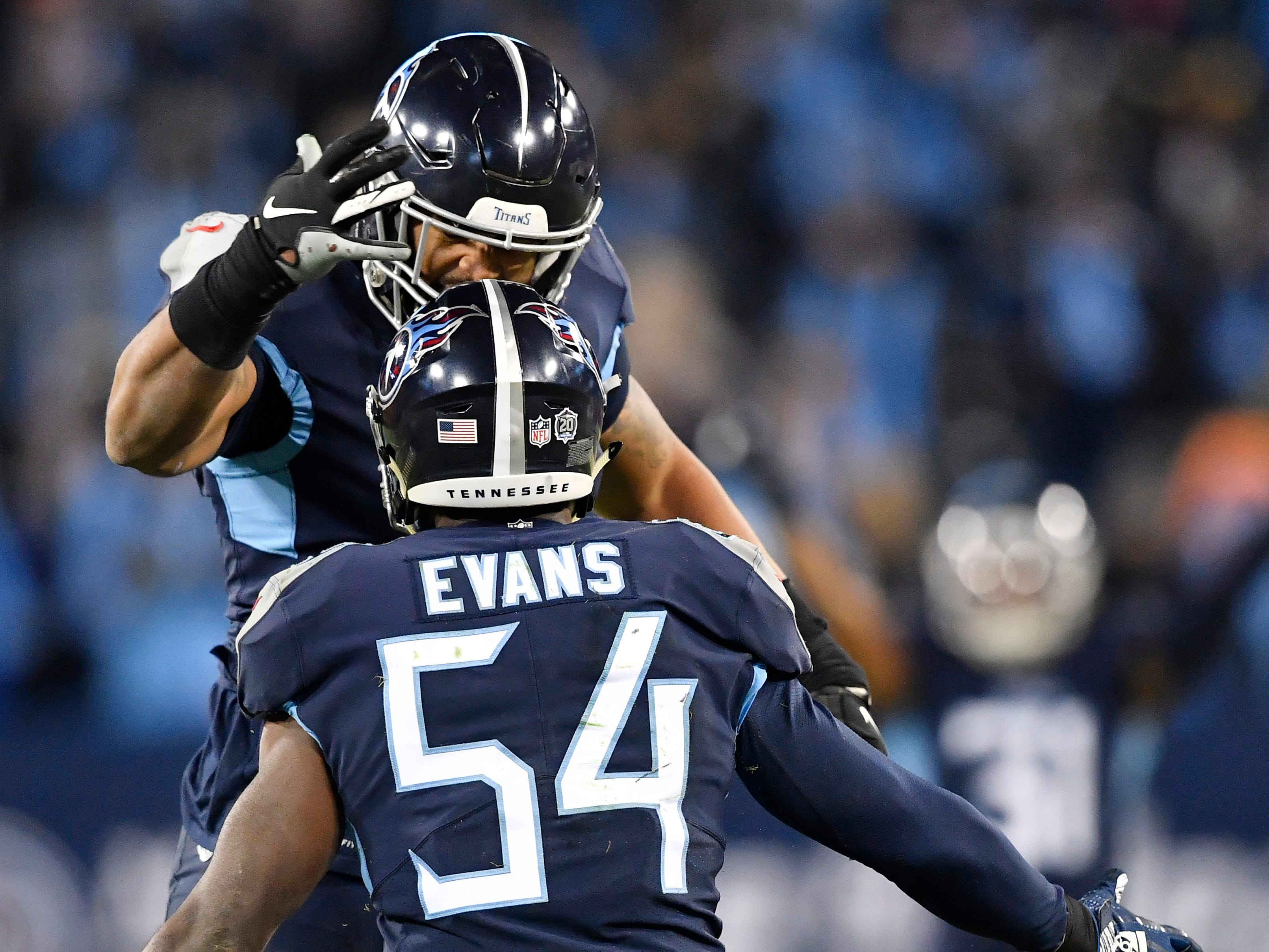 Titans linebackers Derrick Morgan (91) and Rashaan Evans (54) celebrate a play in the fourth quarter at Nissan Stadium Thursday, Dec. 6, 2018, in Nashville, Tenn.
