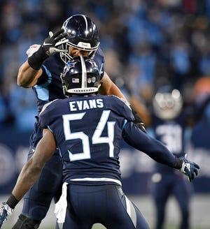 Titans linebackers Derrick Morgan (91) and Rashaan Evans (54) celebrate a play in the fourth quarter at Nissan Stadium Thursday, Dec. 6, 2018, in Nashville, Tenn.
