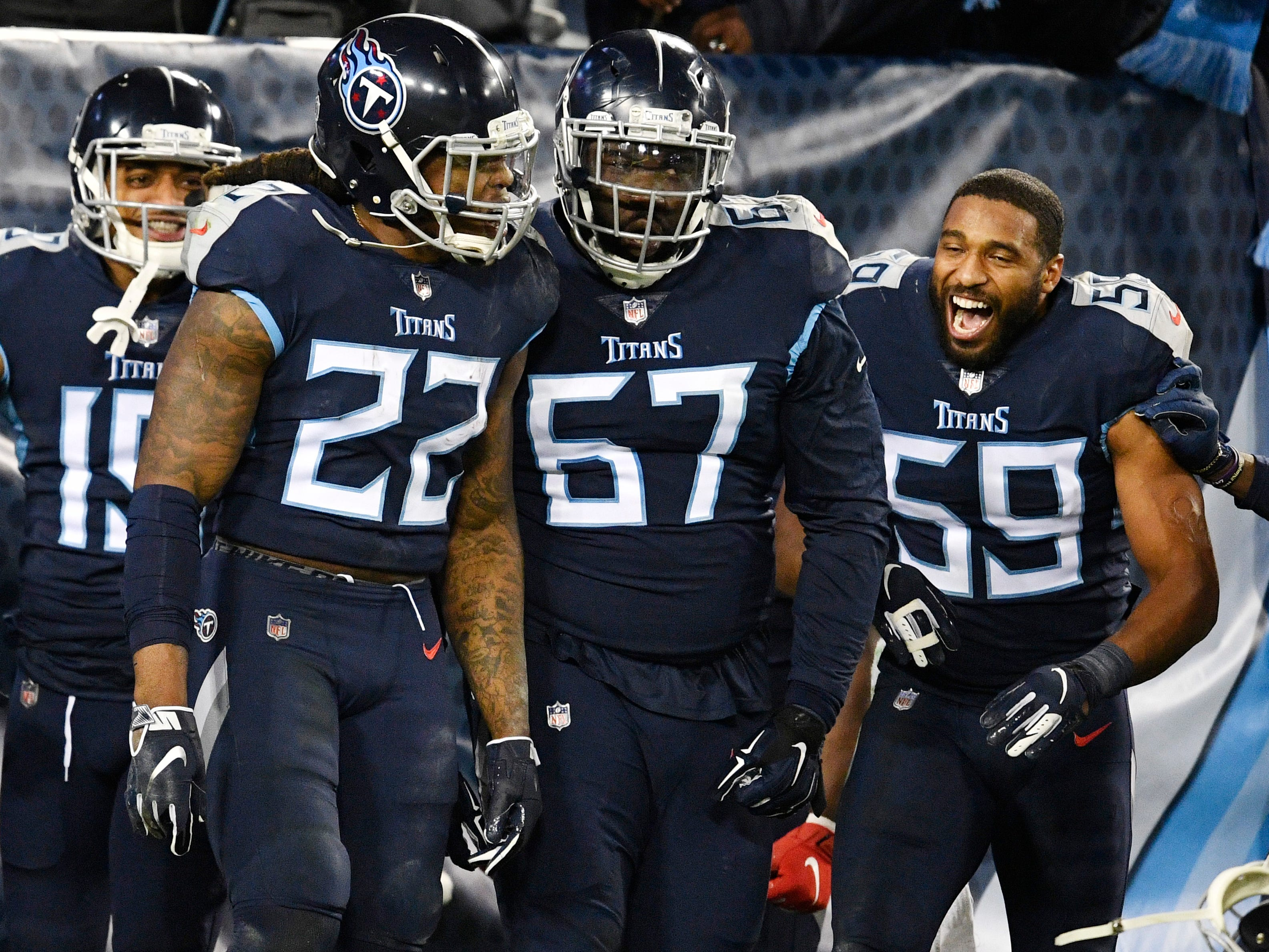 Titans running back Derrick Henry (22) celebrates his touchdown with guard Quinton Spain (67) and linebacker Wesley Woodyard (59) in the second quarter at Nissan Stadium Thursday, Dec. 6, 2018, in Nashville, Tenn.