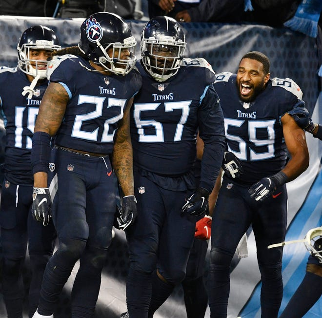Titans running back Derrick Henry (22) celebrates his touchdown with guard Quinton Spain (67) and linebacker Wesley Woodyard (59) in the second quarter Thursday.