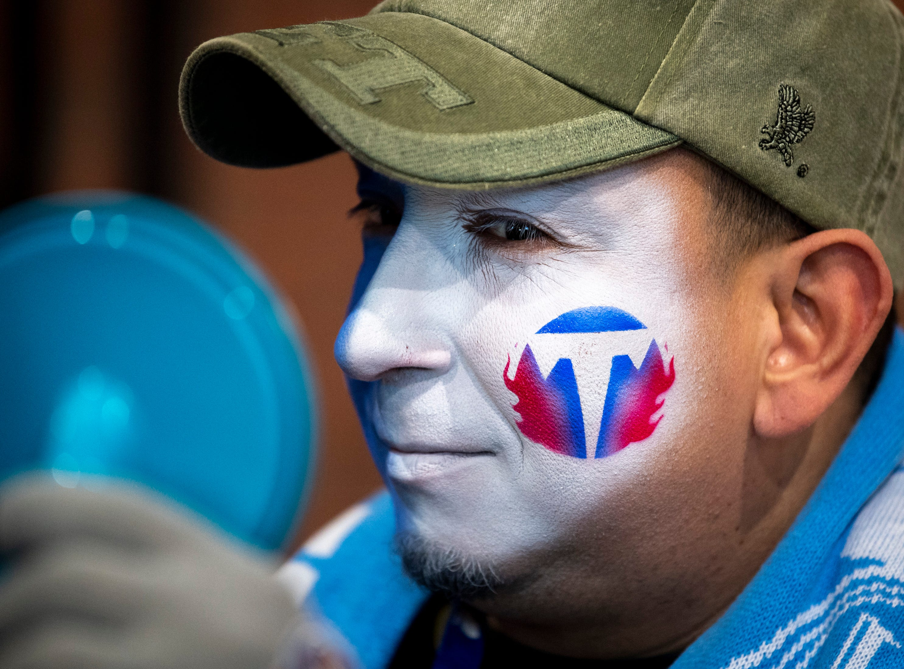 Alex Rivera, of Nashville, checks out his freshly painted face before the game between the Tennessee Titans and the Jacksonville Jaguars at Nissan Stadium in Nashville, Tenn., Thursday, Dec. 6, 2018.