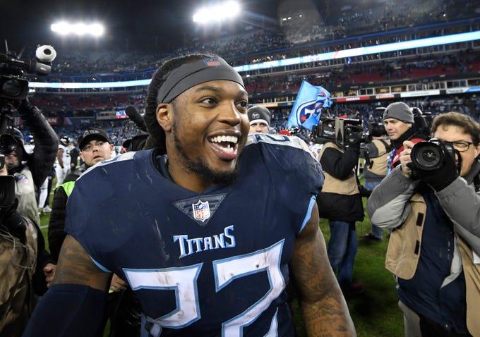 Titans running back Derrick Henry (22) celebrates the team's 30-9 win on his fourth touchdowns at Nissan Stadium Thursday, Dec. 6, 2018, in Nashville, Tenn.