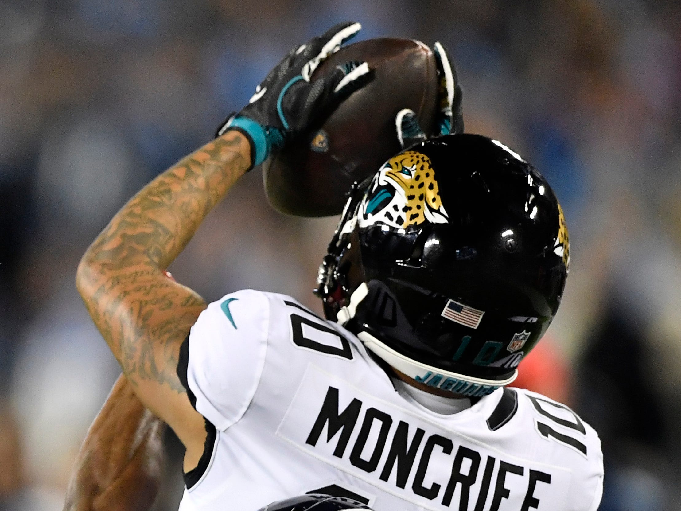 Jaguars wide receiver Donte Moncrief (10) pulls down a catch in the first half at Nissan Stadium Thursday, Dec. 6, 2018, in Nashville, Tenn.