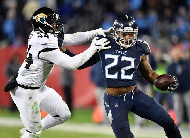 Titans running back Derrick Henry (22) gets away from Jaguars linebacker Myles Jack (44) in the fourth quarter Thursday.
