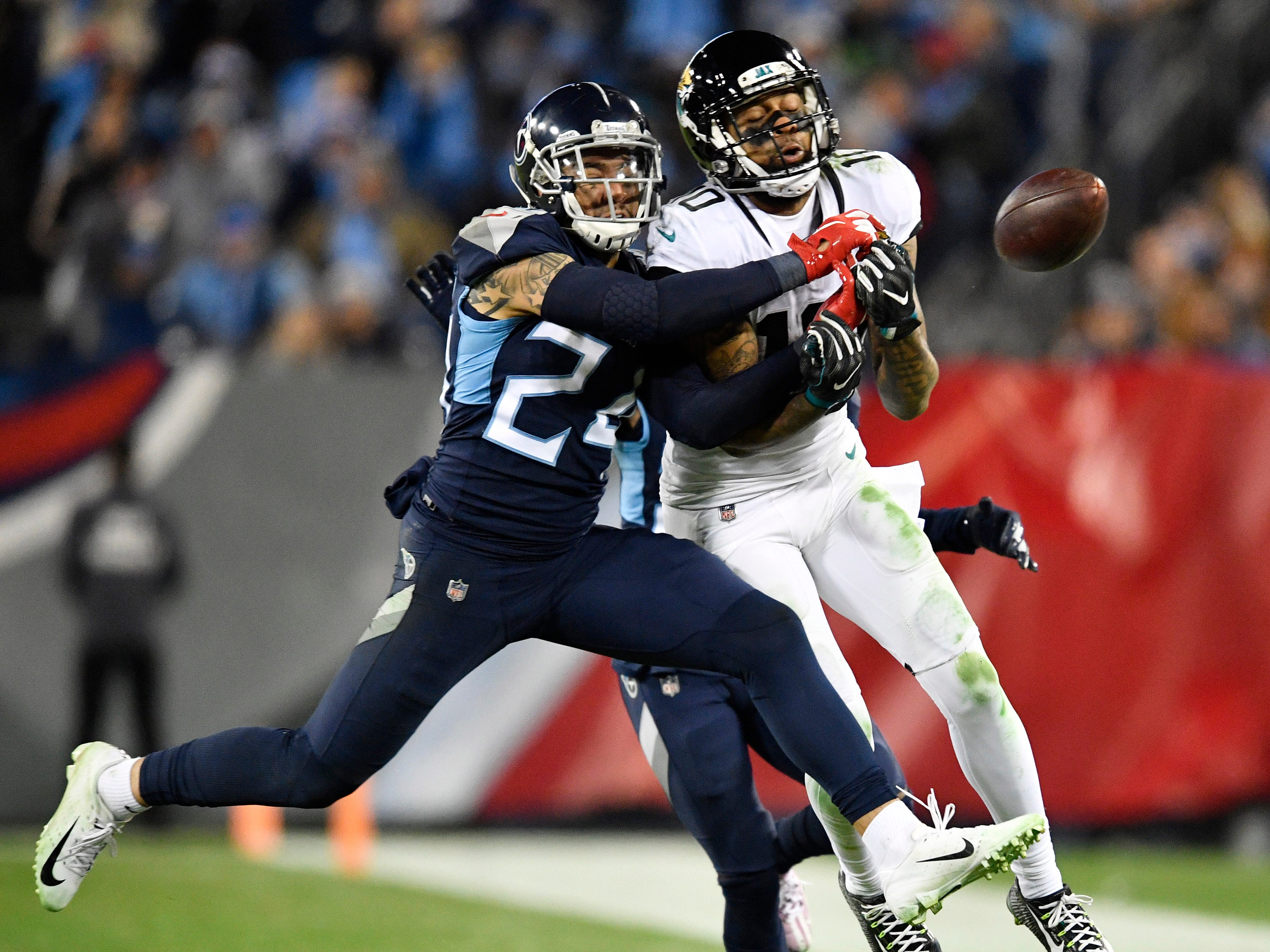 Titans safety Kenny Vaccaro (24) breaks up a pass intended for Jaguars wide receiver Donte Moncrief (10) in the third quarter at Nissan Stadium Thursday, Dec. 6, 2018, in Nashville, Tenn.