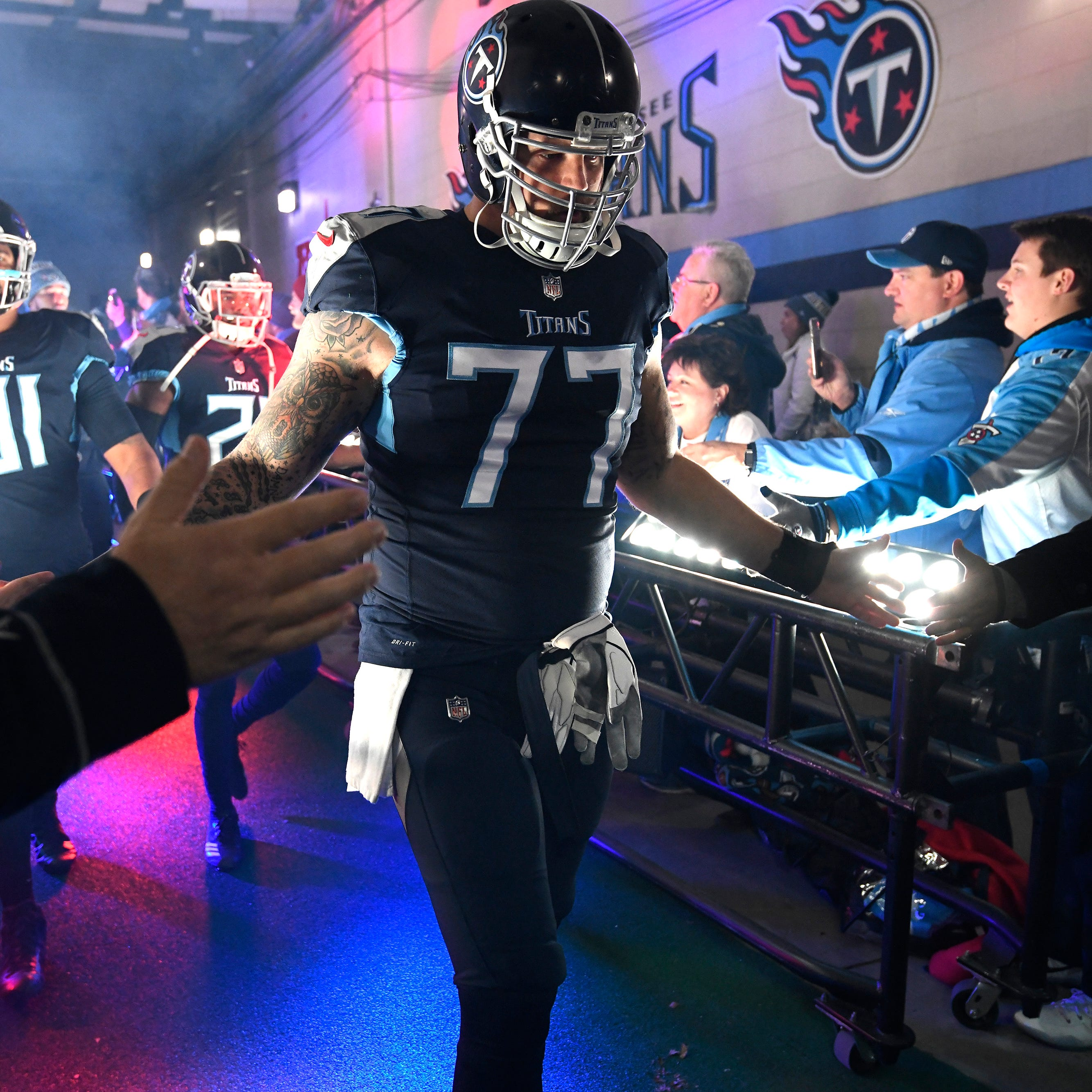 Titans' Taylor Lewan flips off Fox overhead camera after injury vs. Jaguars