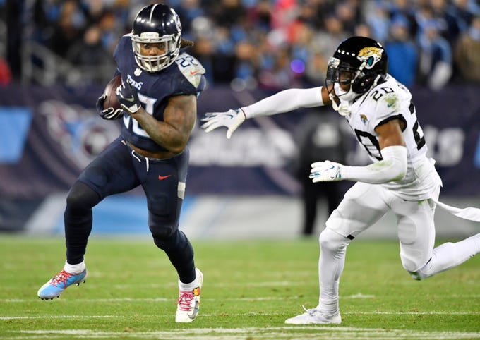 Titans running back Derrick Henry (22) runs away from Jaguars cornerback Jalen Ramsey (20) for his fourth touchdown of the game in the third quarter at Nissan Stadium Thursday, Dec. 6, 2018, in Nashville, Tenn.